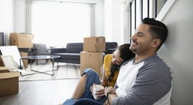new homeowners take a seat in new home